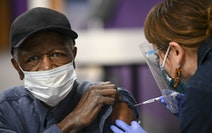 M Health Fairview nurse Nicole Parr administered a dose of the Pfizer BioNTech COVID-19 vaccine Feb. 19 to James Wells, 73, of Minneapolis at Shiloh T