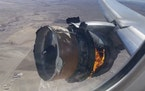 "In this image taken from video, the engine of United Airlines Flight 328 is on fire after after experiencing ""a right-engine failure"" shortly afte"