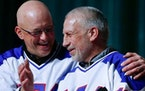 """Jack O'Callahan, left, and Mark Pavelich of the 1980 U.S. ice hockey team talked during the """"Relive the Miracle"""" reunion at Herb Brooks Arena on"""