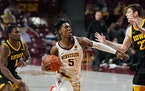 Marcus Carr (5) has four 30-point games this season for the Gophers.