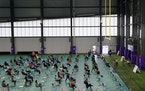 People who had been vaccinated sit inside the Vikings Training Center, which had been converted into a site administering the newly-available, single