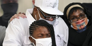 Walter Bell comforted his granddaughter, Sativa, 9, as they were overcome with emotion during Friday's press conference in Minneapolis. Bell's son