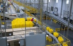 FILE — Inside an Amazon fulfillment center in Kent, Wash., May 29, 2020. New research suggests that when big companies increase wages, like Amazon d