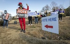 FILE -- Activists from Black Voters Matter work to direct people to polling places in McDonough, Ga., Jan. 5, 2021. The Supreme Court on Tuesday, Marc