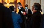 Sen. Joe Manchin (D-W.Va.) is followed by reporters as he walks to the Senate Chamber at the Capitol in Washington on Friday, March 5, 2021.