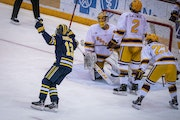 Michigan forward Kent Johnson celebrated a goal by Nick Granowicz during the third period.