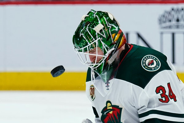 Wild goaltender Kaapo Kahkonen makes a heads-up save against the Arizona Coyotes during the second period Friday.