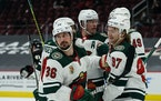 The Wild's Mats Zuccarello (36) celebrates with teammates Kirill Kaprizov (97), Victor Rask (49), Matt Dumba (24) and Jared Spurgeon (46) after scor