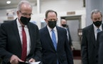 Sen. Jerry Moran, R-Kan., left, Sen. Pat Toomey, R-Pa., and others at the Capitol in Washington, Friday, March 5, 2021.