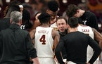 Gophers head coach Richard Pitino talked with his team ahead of the first half Saturday at Williams Arena in Minneapolis.