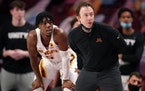 Gophers coach Richard Pitino and guard Marcus Carr (5).
