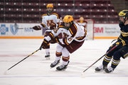 Gophers forward Jack Perbix brought the puck down the ice in the first period Saturday.