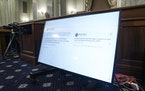 In this Oct. 28, 2020, file photo, Tweets from President Donald Trump are displayed on a screen during a hearing before the Senate Commerce Committee