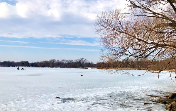 Despite visible slushy patches, two ice fishers took to Lake Hiawatha on Saturday, with temperatures in the 50s and open water across the lake.