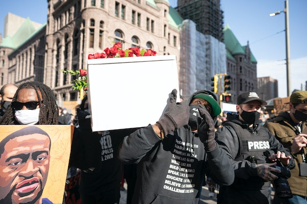 Cortez Rice, left, and Raj Sethuraju carried a mock coffin to mourn the murder of George Floyd during a rally on Sunday in downtown Minneapolis.