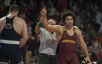 The Gophers' Gable Steveson (shown in a Feb. 2020 match) defeated Michigan's Mason Parris 12-4 to repeat as Big Ten heavyweight wrestling champion