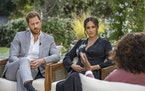 This image provided by Harpo Productions shows Prince Harry, from left, and Meghan, Duchess of Sussex, in conversation with Oprah Winfrey.