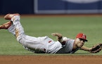 """New Twins shortstop Andrelton Simmons has an effortless, sleek style that more than one MLB observer has described as """"breathtaking."""" He was won f"""