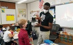 Shad Williams, a second-grade teacher at the School of Engineering and Arts in Golden Valley, talked with a student as the class worked through a less