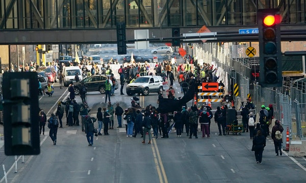 Protesters gathered Monday morning on 3rd Avenue near the Hennepin County Government Center before marching as the trial of former Minneapolis police