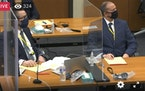 In this image taken from video, defense attorney Eric Nelson left, and defendant, former Minneapolis police officer Derek Chauvin, right, listen as He
