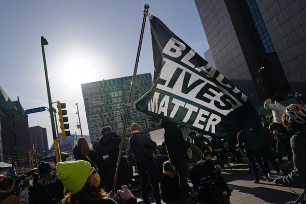A demonstration outside the Hennepin County Government Center on Monday, March 8, 2021, in Minneapolis. Proceedings were beginning in the trial of Der