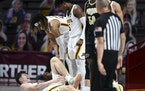 AARON LAVINSKY •Star Tribune Gophers center Liam Robbins battled through left ankle pain against Purdue on Feb. 11.