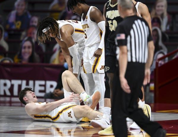 AARON LAVINSKY •Star Tribune Gophers center Liam Robbins battled through left ankle pain against Purdue on Feb. 11.