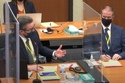 In this image taken from video, defense attorney Eric Nelson left, and defendant, former Minneapolis police officer Derek Chauvin, right, during a hea