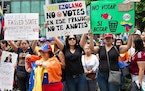Venezuelan exiles protest the presidential elections in Venezuela and primarily against Nicolas Maduro, at the Venezuelan consulate in Miami on May 20