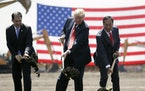 In this June 28, 2018, photo, President Donald Trump, center, along with Wisconsin Gov. Scott Walker, left, and Foxconn Chairman Terry Gou participate