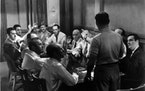 "The jury mulls over a murder case in the 1957 movie ""12 Angry Men."""