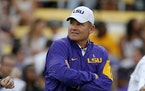 In this Oct. 17, 2015, photo, LSU coach Les Miles watches his team warm up before an NCAA college football game against Florida in Baton Rouge, La. Mi