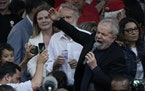 Brazil's former President Luiz Inacio Lula da Silva speaks to supporters after he was released from jail where he was imprisoned on corruption charg