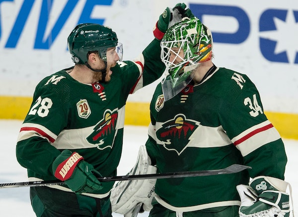 Wild defenseman Ian Cole celebrated with Kaapo Kahkonen after the goalie made 26 saves in shutting out Vegas 2-0 at Xcel Energy Center on Monday night