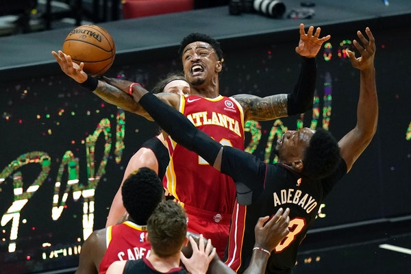 Atlanta Hawks forward John Collins, center top, is reportedly coveted by the Timberwolves.