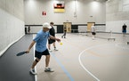Anthony Verderame, of Fridley, served the ball during a pickleball game at the Andover Community Center in Andover, Minn., on Friday, March 5, 2021. V