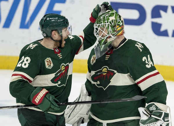 Wild defenseman Ian Cole and goalie Kaapo Kahkonen after Monday's 2-0 victory over Vegas at Xcel Energy Center.