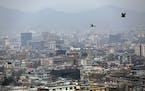 Birds fly over the city of Kabul, Afghanistan, on Feb. 1.