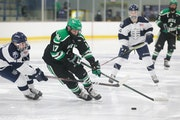 Hill-Murray's Dylan Godbout (17) circles in the offensive zone moments before scoring his second goal of the game against St. Thomas Academy Tuesday