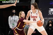 Katie Borowicz of the Gophers guarded Nebraska's Annika Stewart, who played high school basketball at Wayzata, during Wednesday morning's game.
