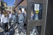 Members of the Rochester Lourdes girls' basketball team left Williams Arena after the MSHSL announced the cancellation of the state tournament on Ma