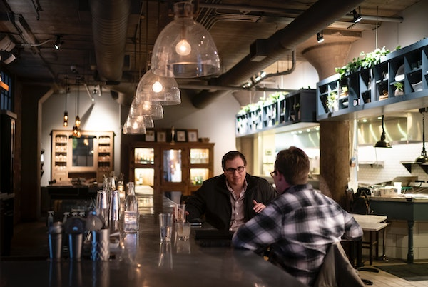 Colleagues Cole Sundquist, of St. Louis Park, and Dalton Cook, of Minneapolis, had drinks at Borough in Minneapolis on Wednesday.