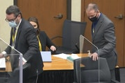 Defense attorney Eric Nelson, left, and defendant former Minneapolis police officer Derek Chauvin take their seats Wednesday after a discussion.