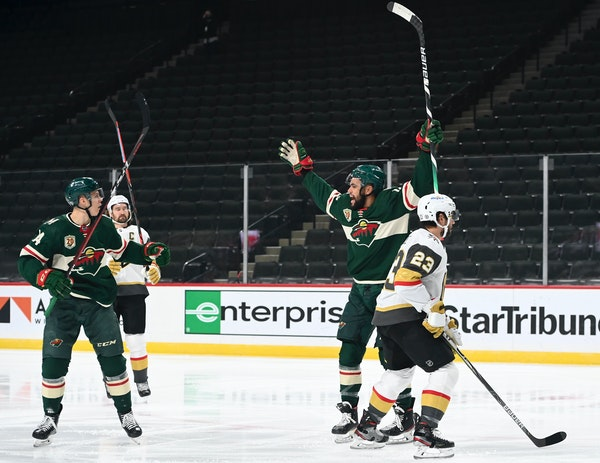 Joel Eriksson Ek (14) and Jordan Greenway (18) celebrated a goal by Eriksson Ek in the first period Wednesday.