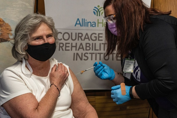 Minnesota Health Commissioner Jan Malcolm got the COVID-19 vaccine from Rachel Slama at the Courage Kenny Rehabilitation Institute in Golden Valley on