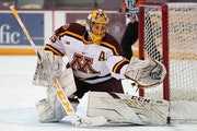 Gophers goalie Jack LaFontaine made a save against Michigan on Saturday in the regular-season finale.