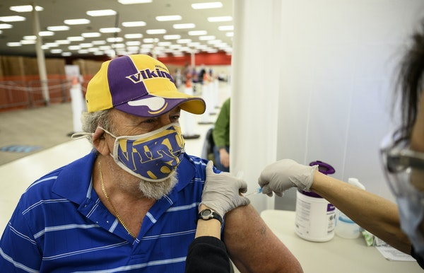 Bill Layer, 71, of Blaine, received a dose of the Moderna COVID-19 vaccine Tuesday at North Memorial Health Hospital's vaccination clinic in Brookly
