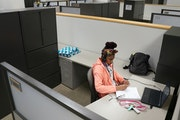 Makyla Davis, 13, sat in a vacant cubical as she took part in a virtual social studies class Wednesday. ] ANTHONY SOUFFLE • anthony.souffle@startrib