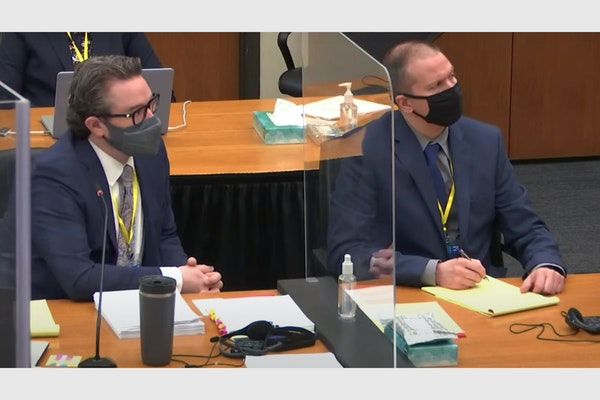 In this image from video, defense attorney Eric Nelson and defendant Derek Chauvin listened before jury selection Thursday, the fourth day in the tria